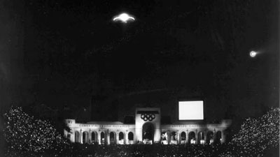 An alien spaceship producing a dazzling display of lights and sound descends on the Coliseum during the closing ceremony of the 1984 Olympics (Los Angeles Times)