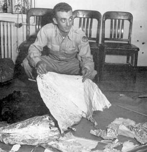 Maj. Jesse Marcel holding fragments of the Roswell crash UFO debris, July 8, 1947