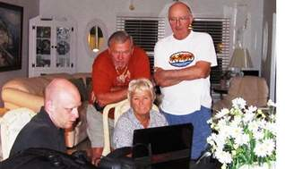 MUFON state director Morgan Beall, seated at left, teaches Chuck Walton, Eddie Hall and Ginny Walton how to use computer software to help identify stars, planets, sattelites and UFOs, using binoculars and a telescope. (marcoislandflorida.com)