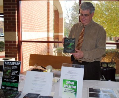 Stan Gordon holds the book he wrote on the Kecksburg UFO incident, which marks its 45th year in December. Marilyn Forbes/For the Daily Courier
