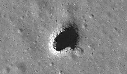 A pit in Mare Ingenii, possibly the result of a collapsed lava tube. Natural tunnels like this would be ideal sites for an alien moon base. Photograph: NASA