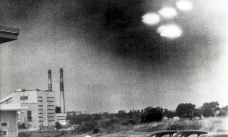 This picture, taken by a coastguard through a window in Salem Massachusetts, US, in the summer of 1952, shows four unidentified flying objects as bright lights in the sky. Photograph: Popperfoto