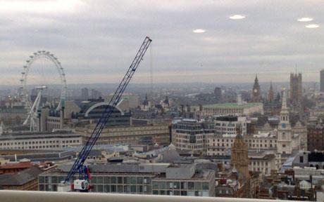 Photograph taken by Derek Burden of the London skyline which shows four UFOs in the sky Photo: ARCHANT