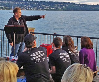 MIIHS Organizer Steve Edmiston points towards Maury Island, where an alleged UFO incident occurred some 65 years ago