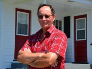 Peter Goreham stands in front of the family home in Bear Point where he witnessed an unidentified flying phenomenon as a 13-year-old in 1967. (BRIAN MEDEL / Yarmouth Bureau)