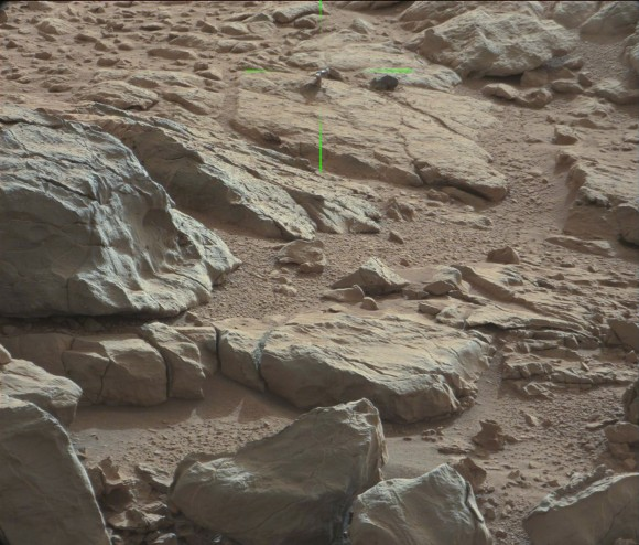 Green lines point to a shiny protuberance on rock imaged by the Curiosity rover on Mars. Credit: NASA/JPL/CaltechMalin Space Science Systems. Image processing 2di7 & titanio44 on Flickr
