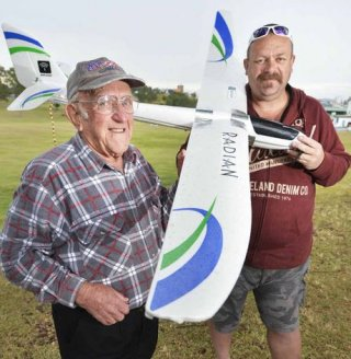 FLIGHT OF FANCY: Arthur Sollitt checks out the UFO with glider owner Schultzy, who flies the aircraft at night. Rob Williams