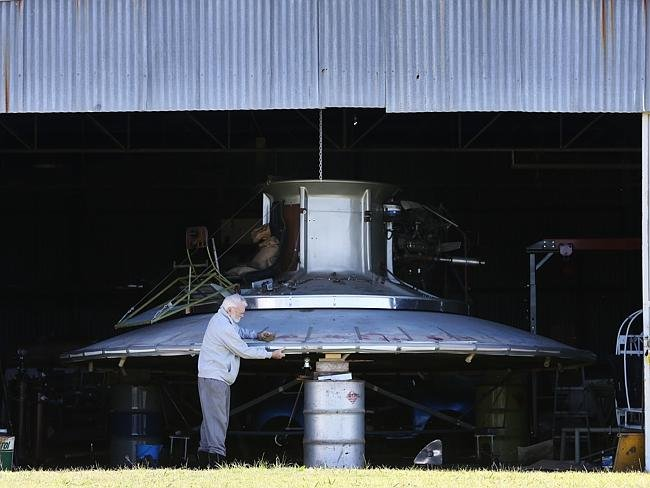 Duan Phillips, 86, with the flying saucer he has been building at Rutherford Aerodrome in Maitland in the Hunter Valley. Pictures: Liam Driver Source: News Corp Australia