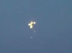 UFO Ejects Spheres over Sea in Poland