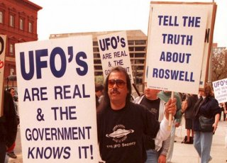 Protesters march in front of the General Accounting Office (GAO) in Washington D.C. in 1995. During the Clinton Administration, the GAO was examining documents about a weather balloon crash in Roswell, N.M. in 1947. At this time, then-President Bill Clinton was also attempting to gather the truth regarding the crash at Roswell, Area 51, and the alleged visitation by extraterrestrials. (Joshua Roberts/AFP/Getty Images)