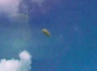 Cloaked' Cigar-Shaped UFO Spotted Over Castle Ruins In Tulum, Mexico