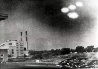 Popperfoto / Getty Images A picture, taken through the window of a laboratory by a U.S. coastguard, shows four unidentified flying objects as bright lights in the sky, in Salem, Mass. on Aug. 3, 1952.