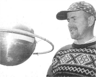 Carpenter craftsman, Lawrence Praill, with the UFO he found at Casablanca Nurseries at Colemans Hatch in 1998
