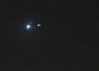 This is the moment a UFO appears in space near the largest planet in the solar system.